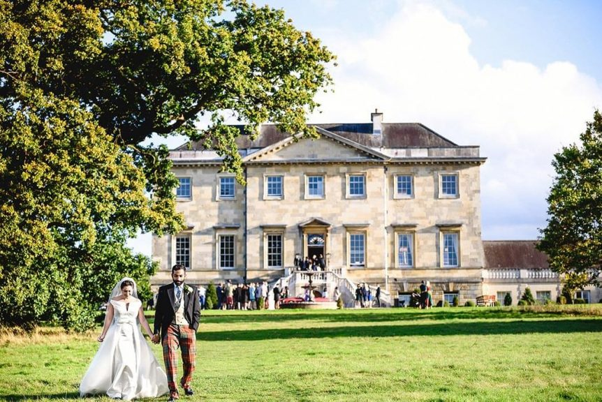 Bride and groom portrait at Botleys Mansion taken by an Essex Wedding Photographer