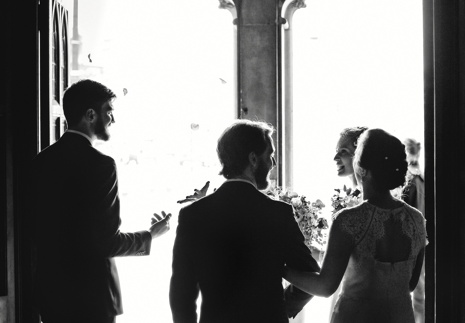Bride and groom leaving church ceremony with their best man and chief bridesmaid