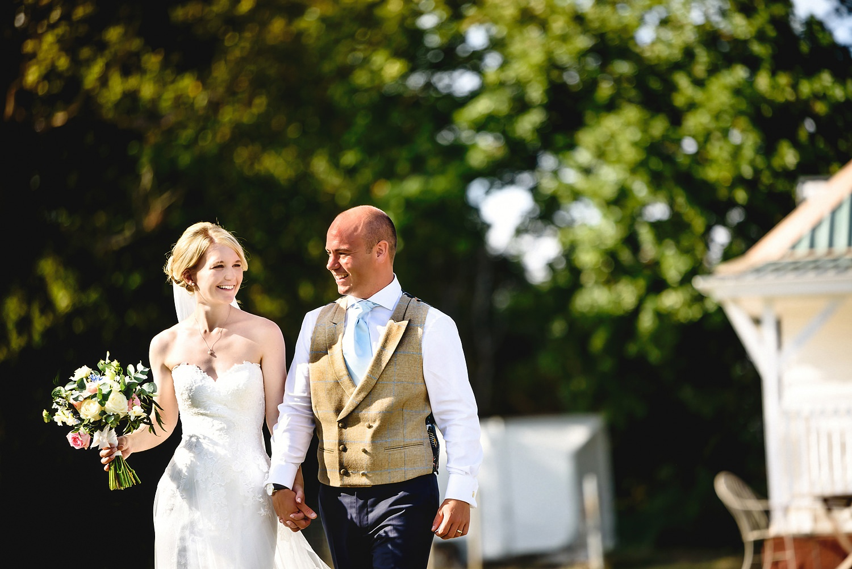 Bride and groom walking portrait taken by an Essex Wedding Photographer