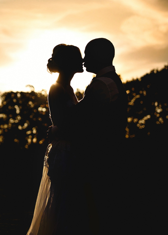 Bride and groom silhouette portrait taken by Essex Wedding Photographer