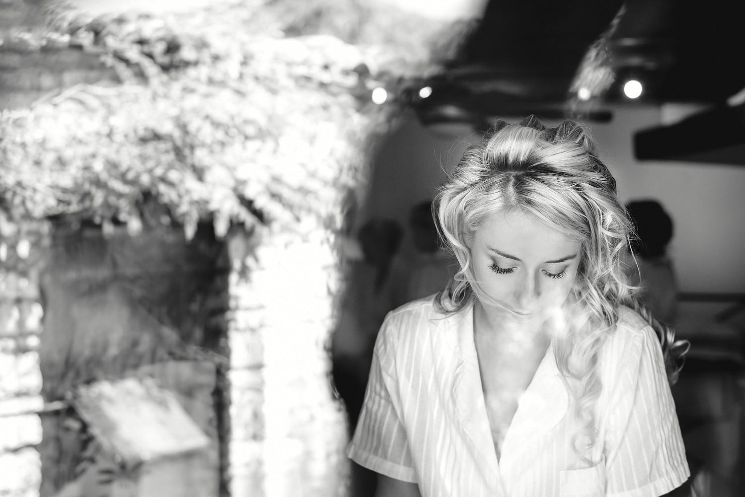 Bride getting ready at a destination wedding in Italy taken by an Essex Wedding Photographer