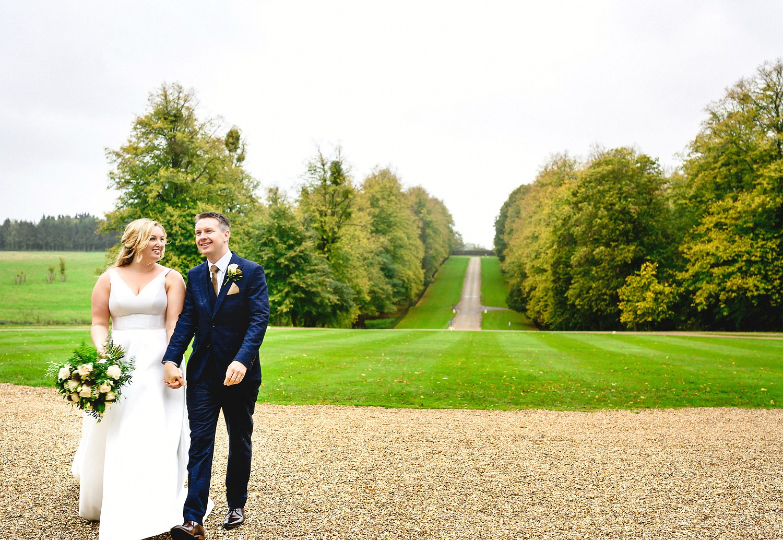 Bride and groom walking portrait at Braxted Park Wedding Venue