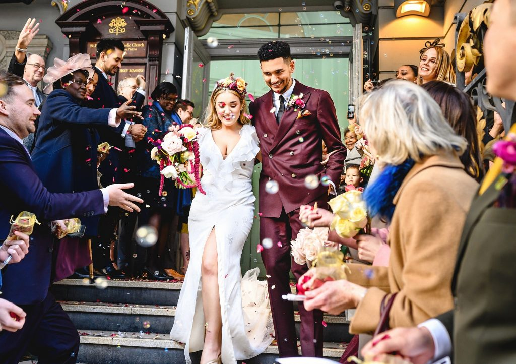 Bride and groom confetti shot outside church ceremony taken by Essex Wedding Photographer