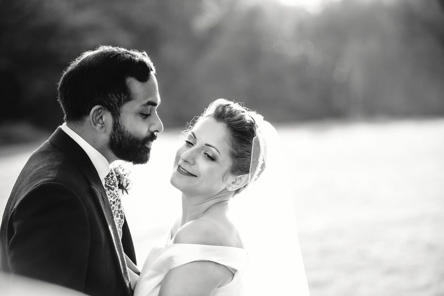 Black and white portrait of bride and groom at Botleys Mansion