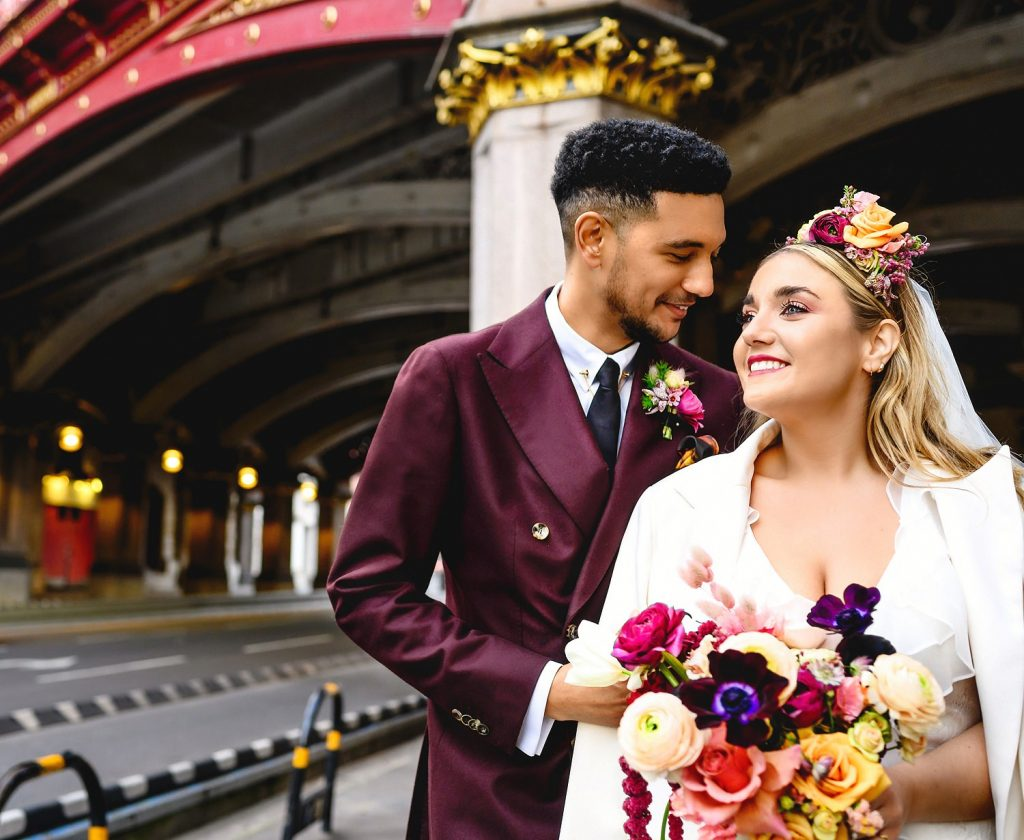 Bride and groom portrait holding bouquet taken by a London Wedding Photographer