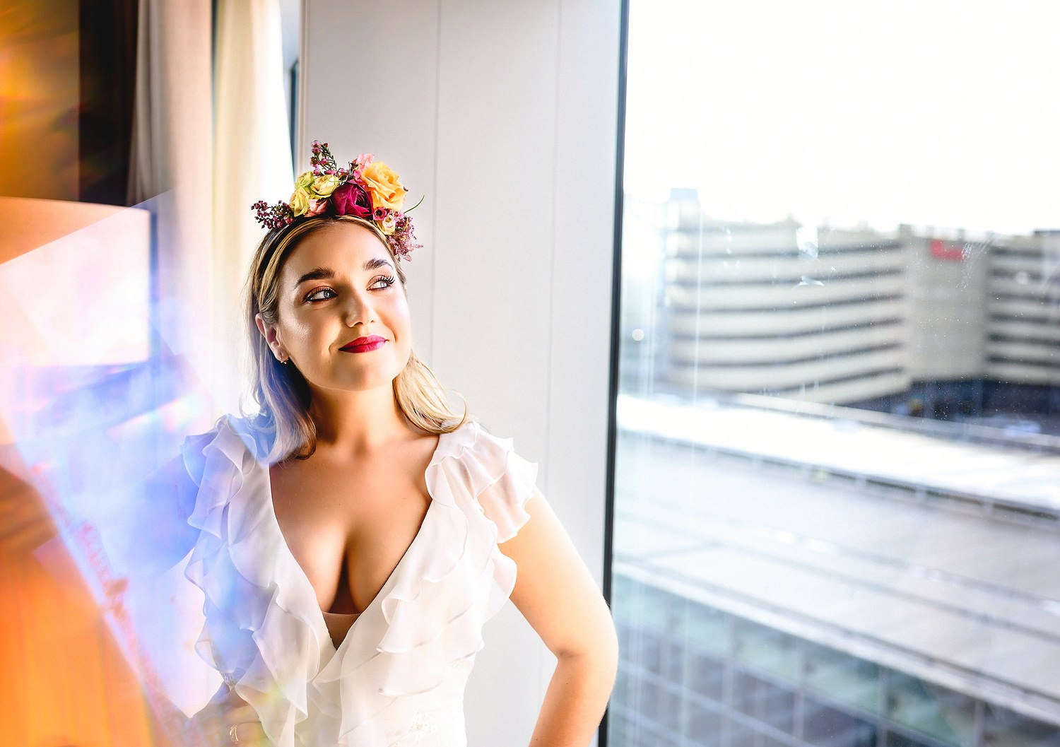 Bride posing by the window at The Stratford Hotel in London