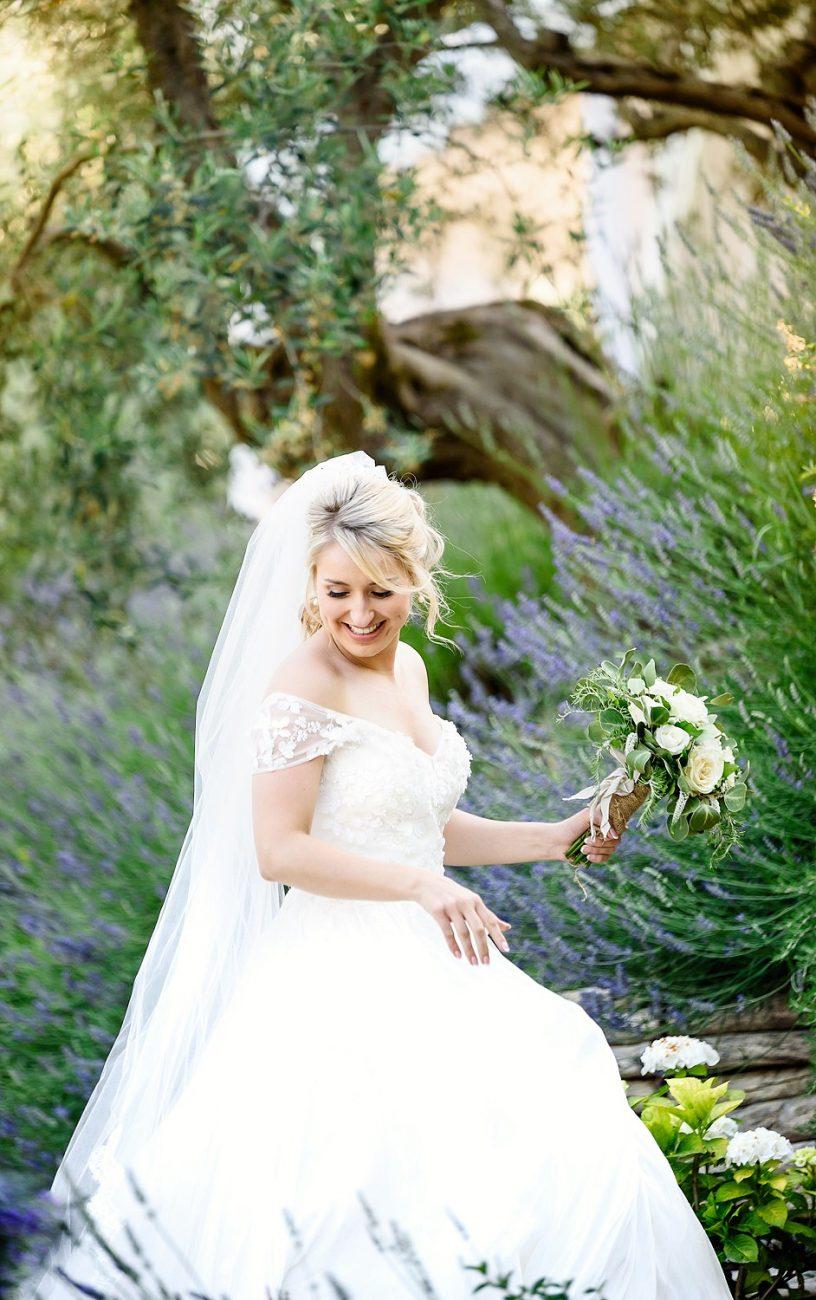 bride having her portrait with her bouquet