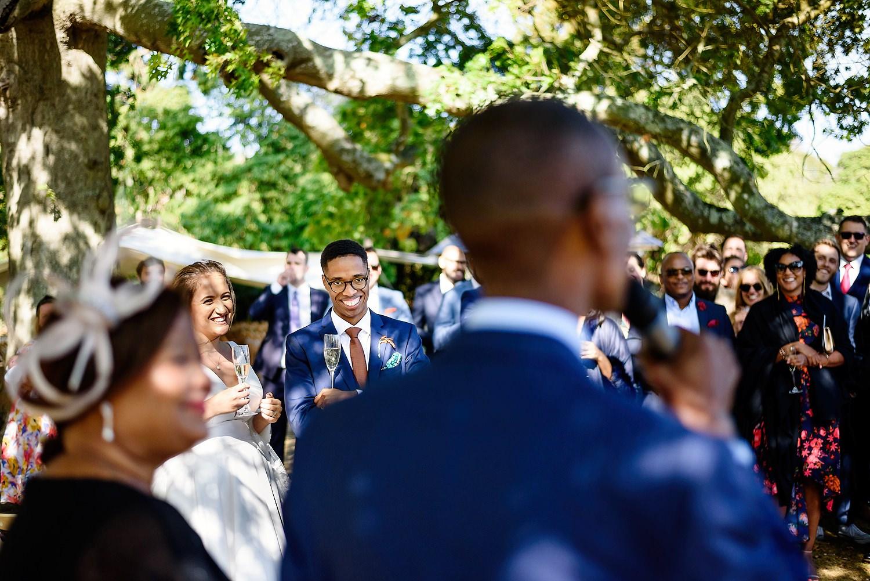 father giving a speech at a wedding