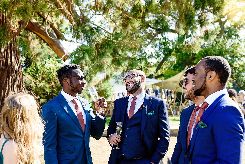 groomsmen drinking at a wedding