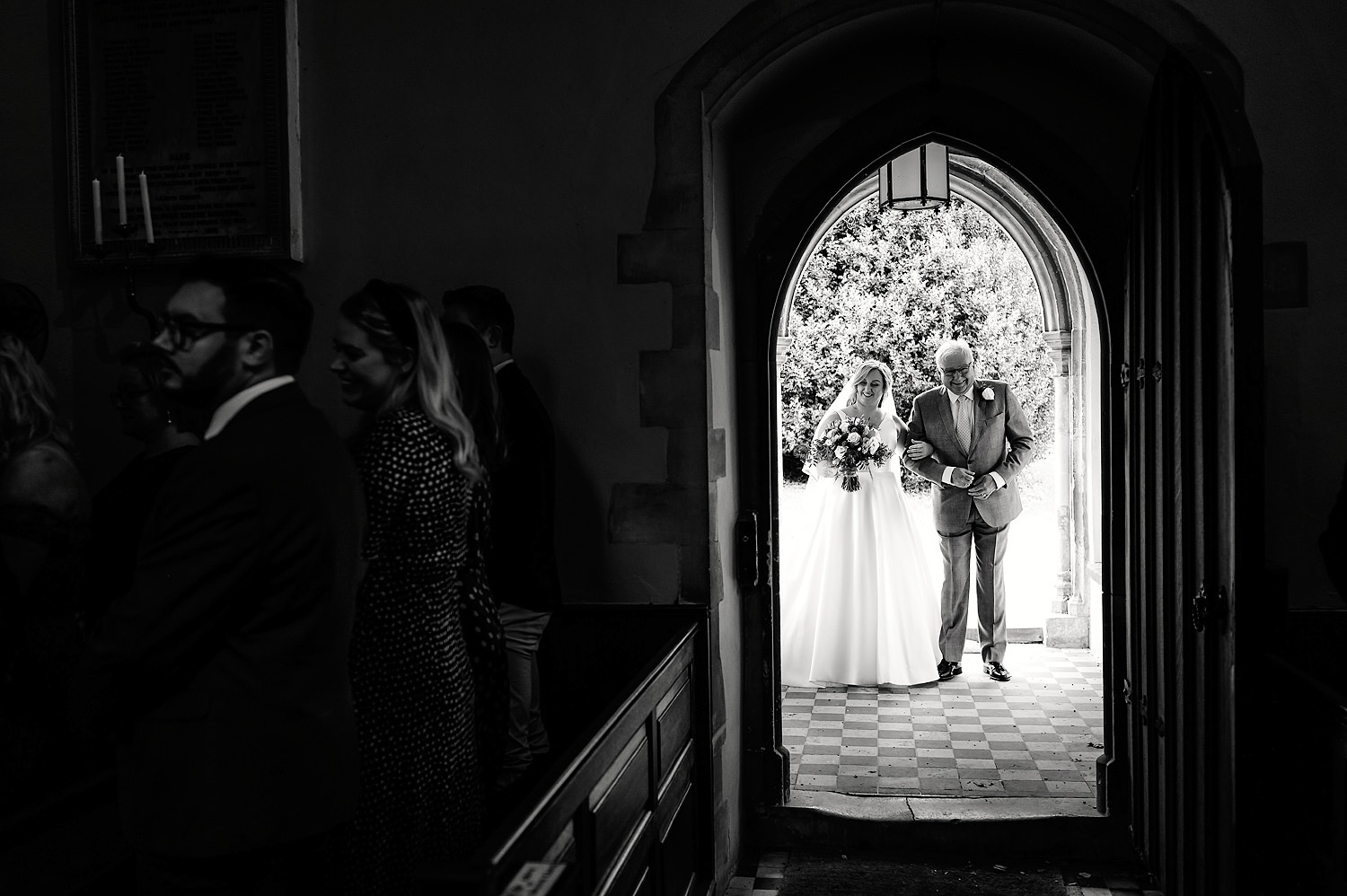 father and bride at church ceremony