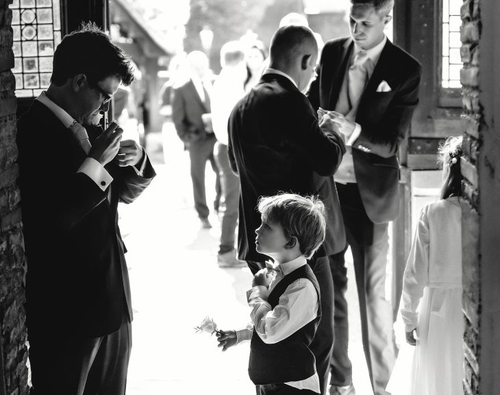 Father and son getting ready at a wedding ceremony in Essex