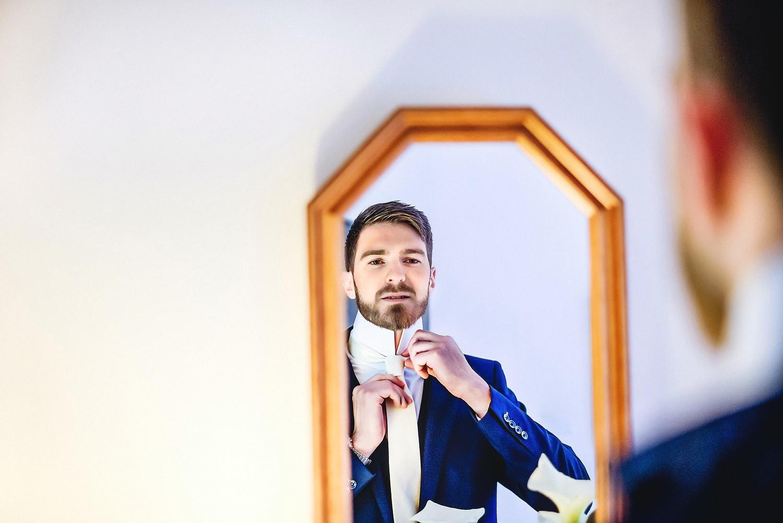 Groom getting ready in the mirror at destination wedding in Dublin