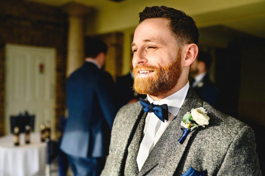 Groom portrait at Friern Manor Wedding Venue in Brentwood taken by Essex Wedding Photographer