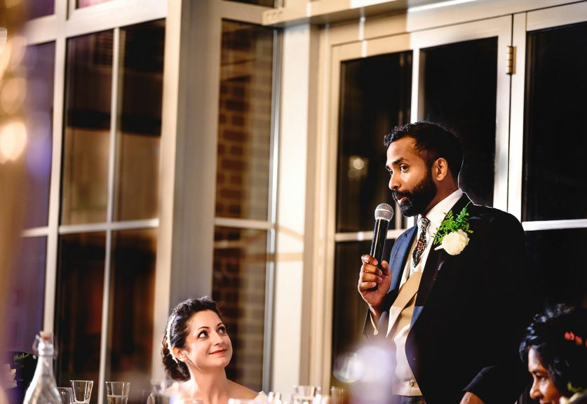Groom giving his speech to guests at Botleys Mansion wedding venue in Surrey