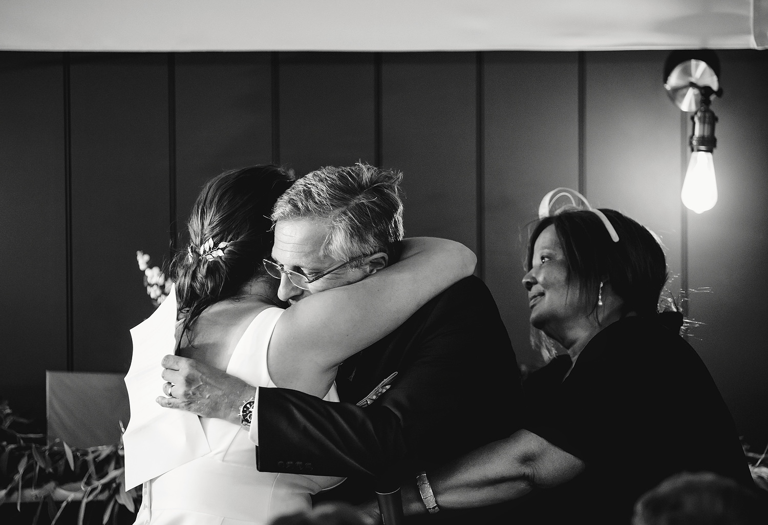 Bride hugging father after his speech at Pylewell Park wedding venue in Hampshire