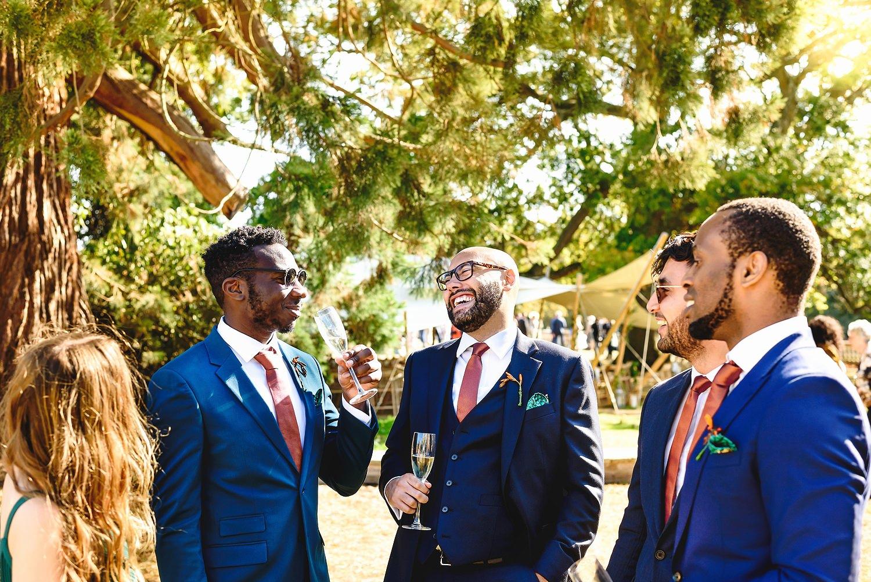 Groomsmen drinking champagne at Pylewell Park wedding venue