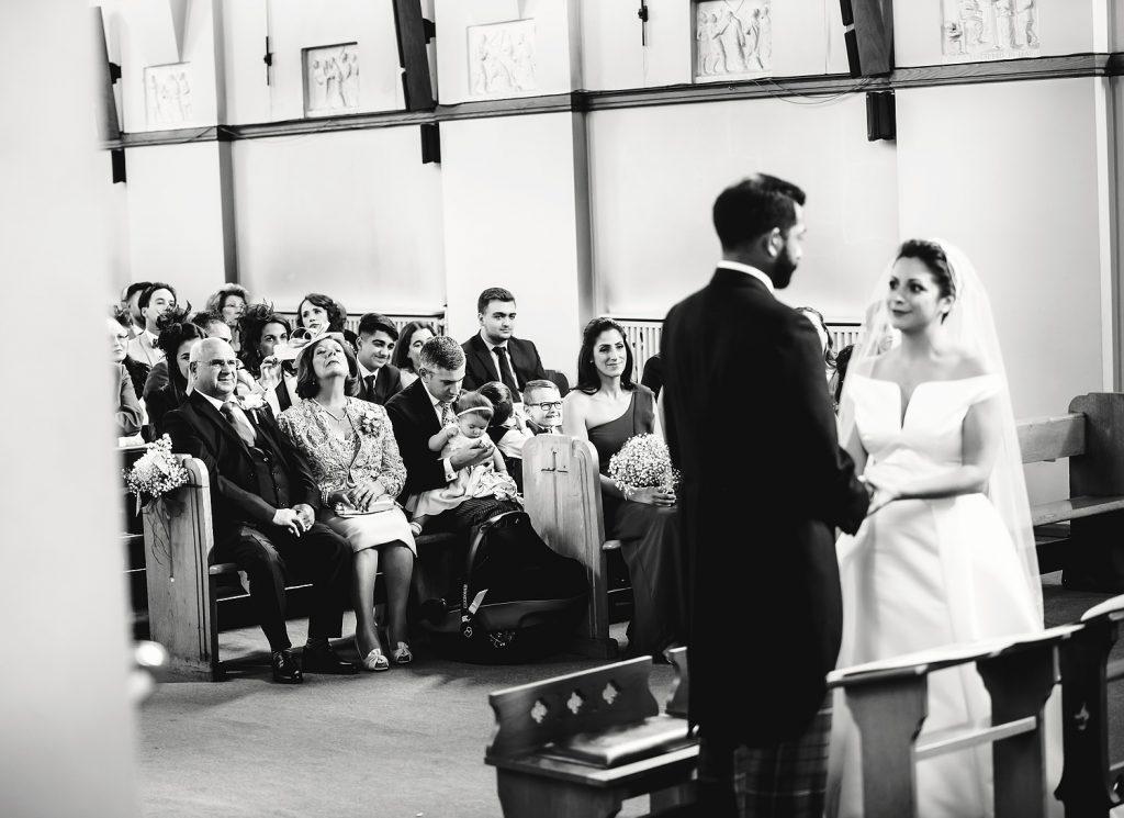 parents watching bride and groom