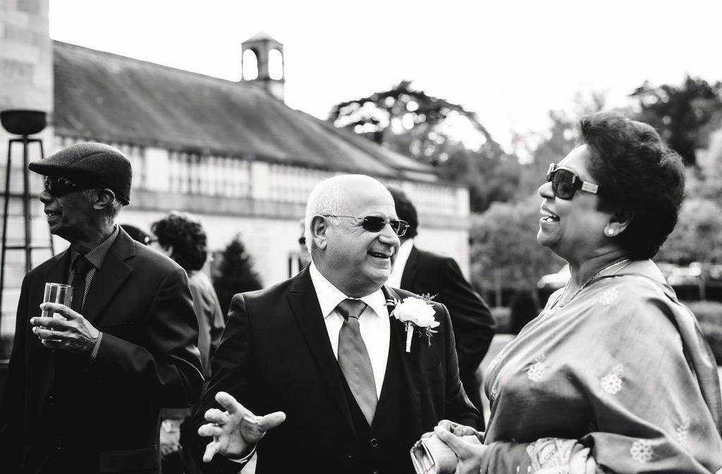 wedding guests laughing at botleys mansion