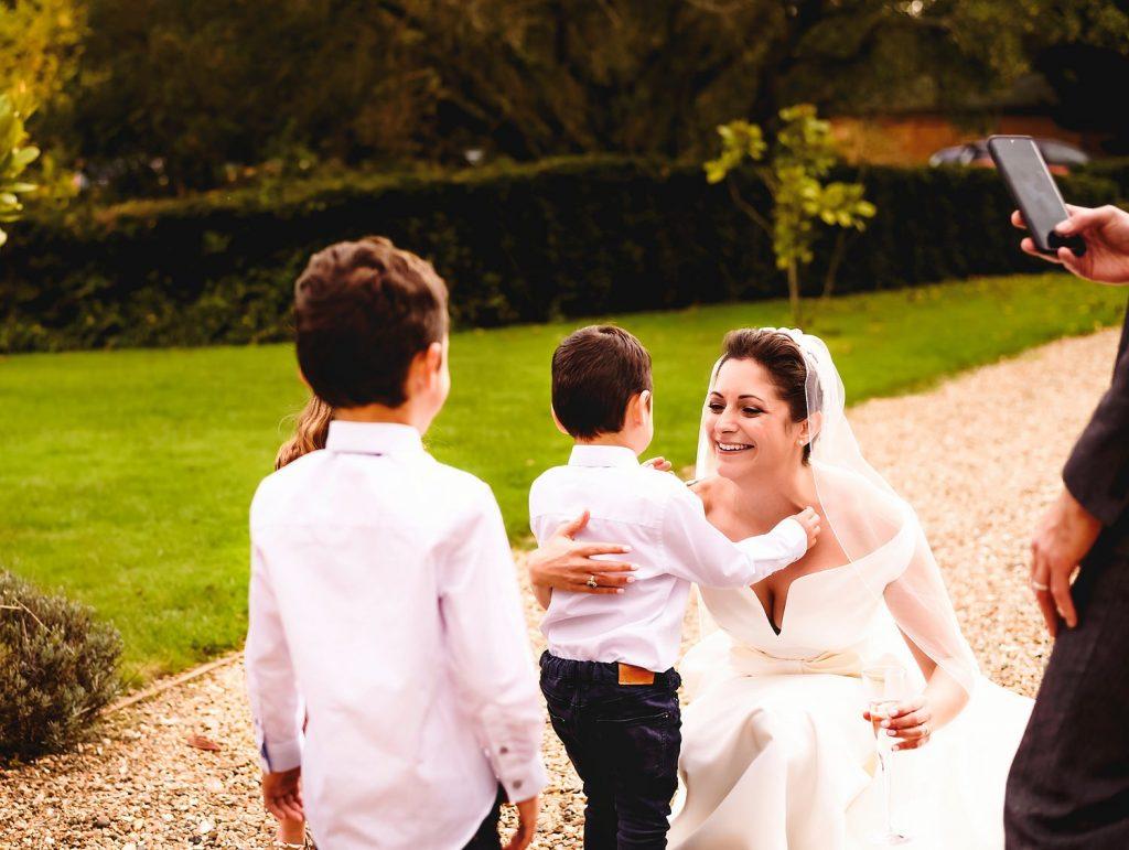 bride greeting children