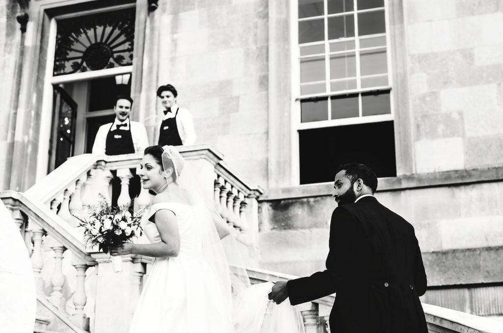 bride and groom walking up stairs