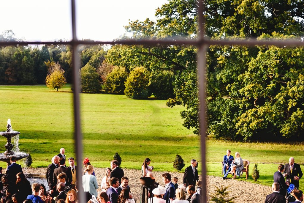 wedding guests on lawn at botleys mansion