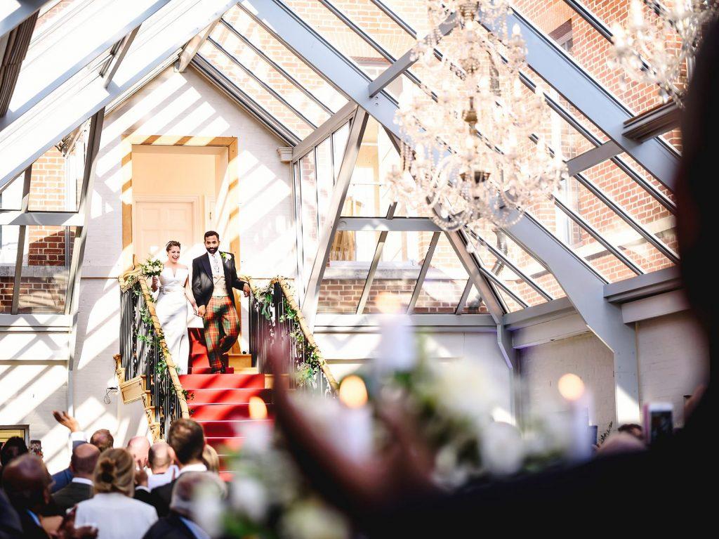 bride and groom entrance into botleys mansion wedding venue